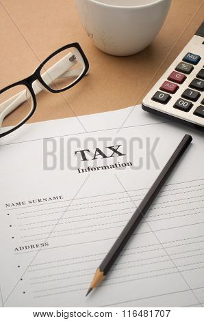 Office Desk With Tax Information, Glasses And Black Pencil.