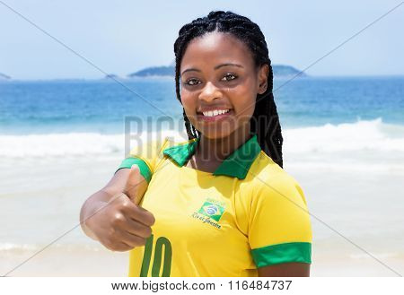 Brazilian Woman In A Soccer Jersey At Beach Showing Thumb