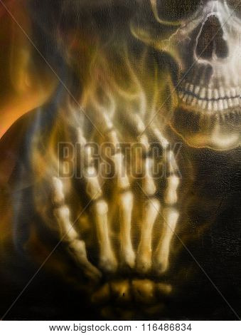 detailed skull and skeleton hand and  fire, on black background.