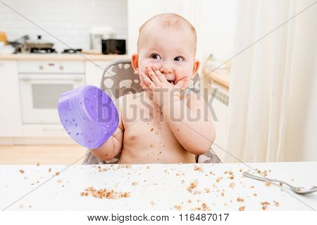 Little Baby Eating At Kitchen