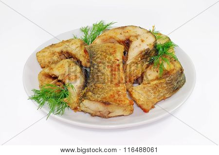 Fried fish, Alaska Pollock or Hake slices on a plate isolated Against white background