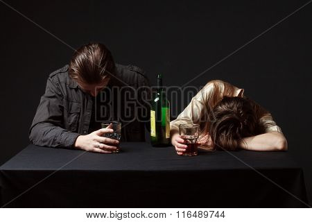 Drunk Couple, Man And Woman Are Seeping On The Table, Steel Keeping Glasses