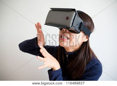 Woman feeling scary with virtual reality glasses