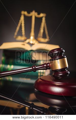 learning to be fair and just, law and justice concept, wooden judge's gavel on a book in front of golden scale