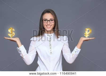 businesswoman holding ruble and dollar symbols or signs.