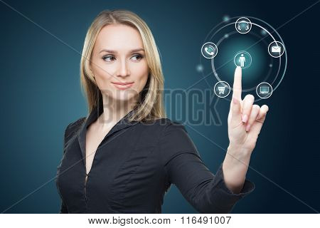 Young woman pressing various collection of high tech buttons