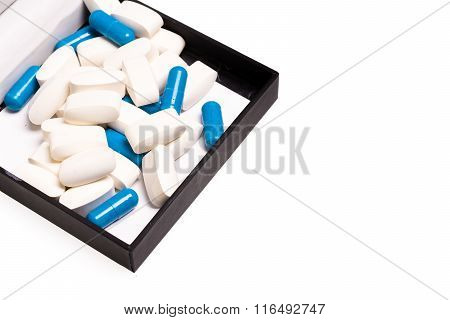 Medical pills in a black luxury box for good health