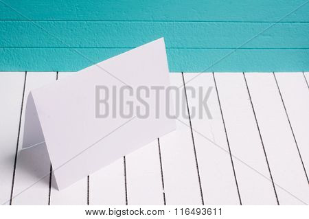 Blank sheet of paper against a background  white wood