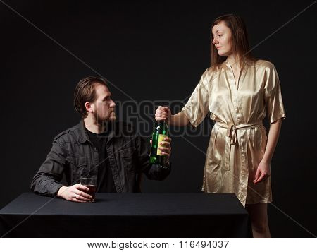 Man Is Drinking Alcohol, The Bottle In The Hand