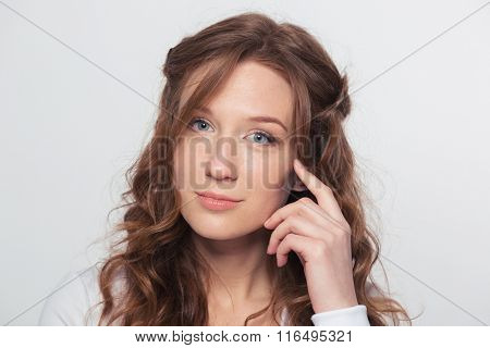 Beauty portrait of a young woman loooking at camera isolated on a white background