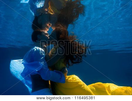 Man and Woman kissing underwater in the swimming pool