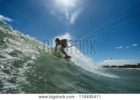 Kitesurf freestyle ride his kite