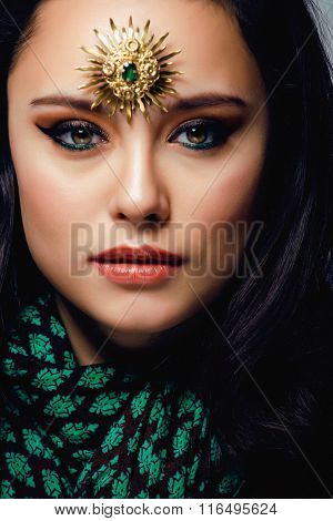 beauty eastern woman with jewelry close up, bride star brooch bright colored