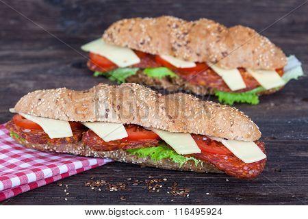 Two long ciabatta sandwiches