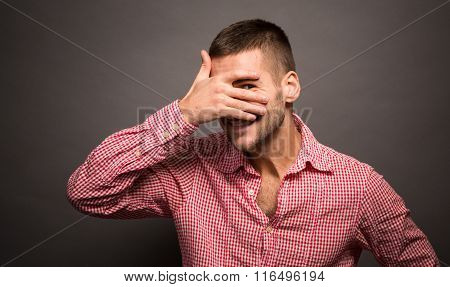 Man covering eyes his face