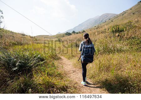 Back view of woman go hiking