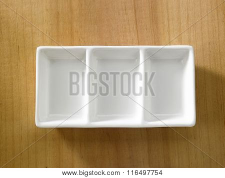 rectangular saucer on the wooden background