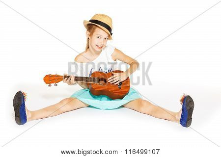 Beautiful little girl with a guitar