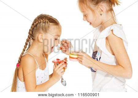 Little girls eating jello