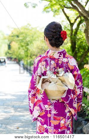 The back view of woman with kimono