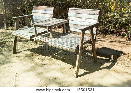 Double Chairs Standing In The Garden With Shadows