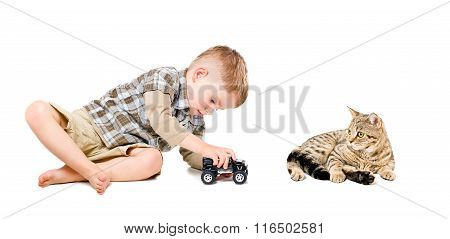 Beautiful boy playing toy car together with cat