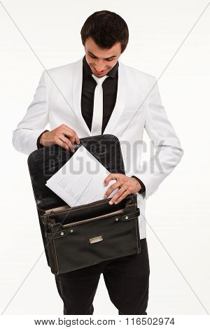 Clerk putting documennts in briefcase.