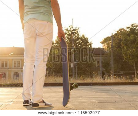 Young man with skateboarding.