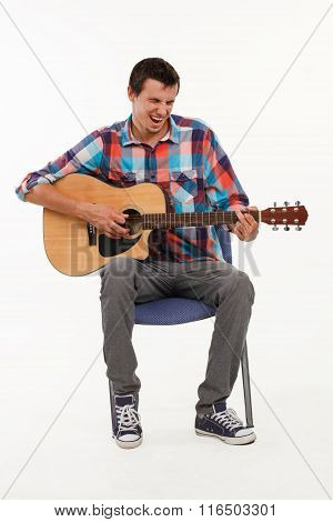 Musician playing his guitar.