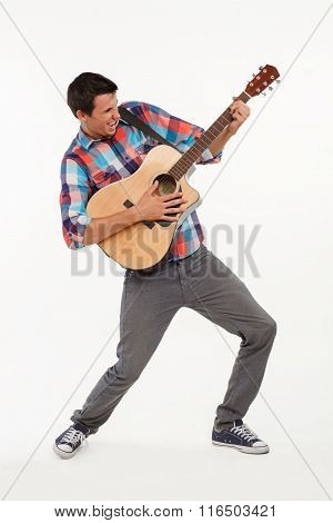 Emotional musician playing his guitar.