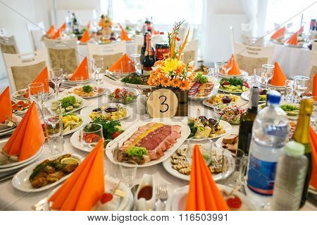 Stylish Luxury Decorated Orange Tables With Flowers And Number For The Wedding Celebration  Of Happy