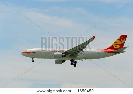 HONG KONG - JUNE 04, 2015: Hong Kong Airlines aircraft landing at Hong Kong airport. Hong Kong Airlines Ltd is a Hong Kong-based airline, with its main hub at Hong Kong International Airport.