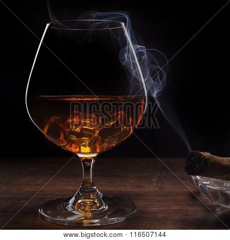 whiskey and smoking a cigar
