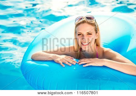 Beautiful young woman in the swimming pool