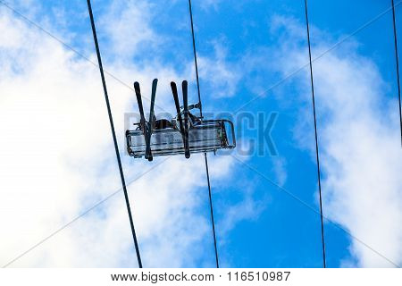 Skiers have a fun on chair lift in the sky