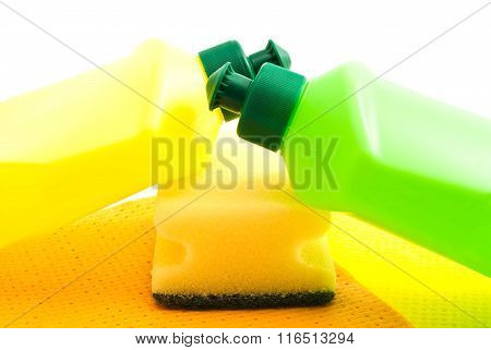 Two Bottles, Rags And Yellow Sponge