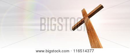 Concept or conceptual wood cross or religion symbol shape over a rainbow sky with clouds background banner