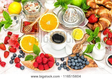 Breakfast With Coffee, Croissants, Granola, Honey, Berries, Fruits. Healthy Food