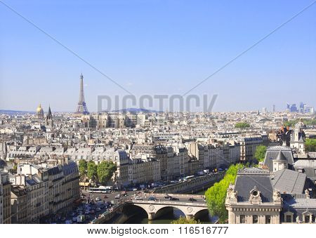 Overlooking Paris up on Notre Dame de Paris and river Seine, France