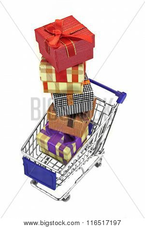 Shopping Cart With Stack Of Gift Boxes Isolated On White