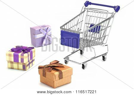 Many Gift Box And Empty Shopping Cart Isolated On White