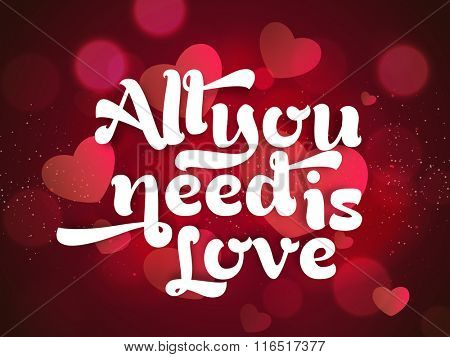 Creative text All You Need is Love on beautiful hearts decorated shiny background for Happy Valentine's Day celebration.
