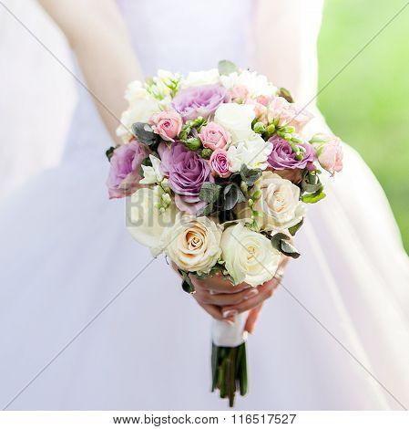 Bouquet Of Roses In Bride's Hands.
