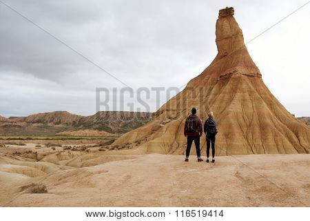 Back view of man and woman looking on beautiful landscape mountains during adventure trip