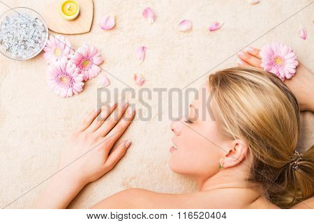 Young beautiful woman relaxing on the massage table