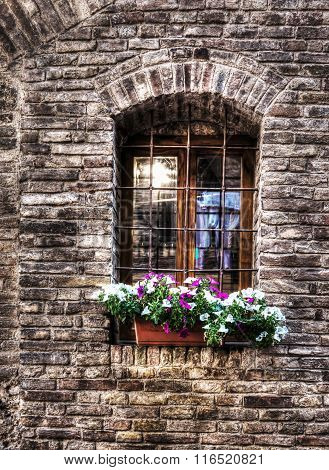 Rustic Window With Metal Grill In A Brick Wall