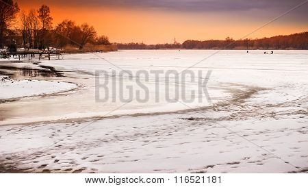 Winter Landscape With Sunset Fiery Sky, Over Frozen River