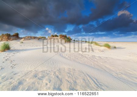 Sand Dune And Blue Sky By Sea