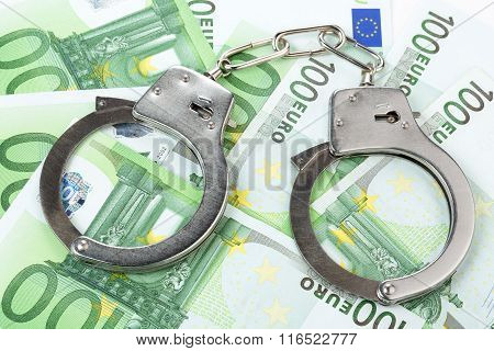 handcuffs on banknotes