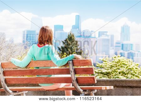 Young woman in Seattle park look at downtown